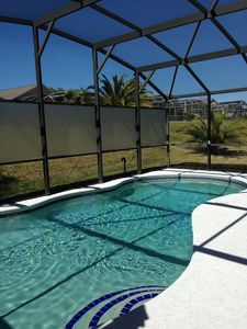 Spacious pool deck with screen