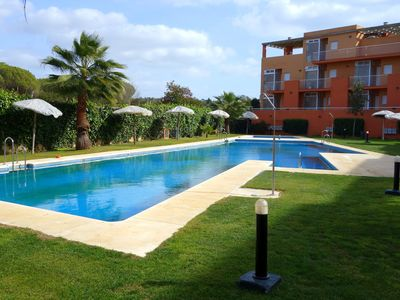 Photo for Apartment with large terrace and private garden, Islantilla Golf Course