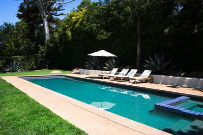 heated pool with jacuzzi and sundeck patio