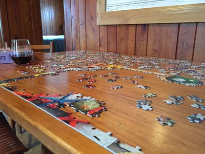 After a long day on the water... enjoy a glass of wine and puzzle.