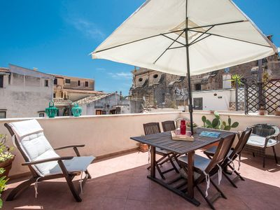 Photo for Stylish Terrace on the rooftops of La Kalsa by Wonderful Italy