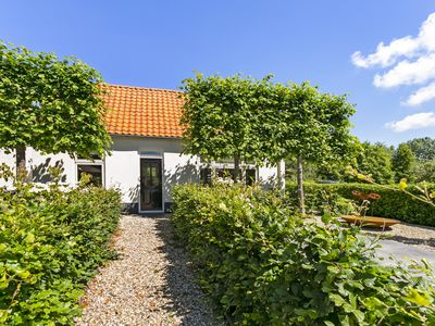 Photo for Cozy cottage with 2 bedrooms, garden and terrace by the beach