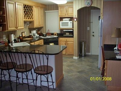 Kitchen with granite countertops and hardwood cabinets