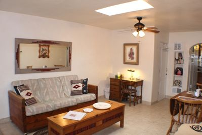 The living/dining area with Taos style couch and small desk perfect for working.