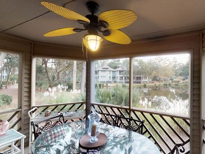 Photo for Lakefront villa w/ screened porch & great view - walk to beach, tennis & golf!