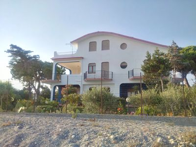 Photo for Majestic and panoramic villa directly on the beach of Bova Marina