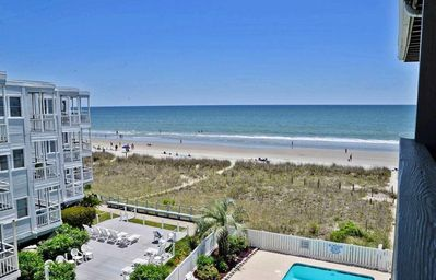 Photo for Beach front condo w/ pool close to Barefoot Landing!