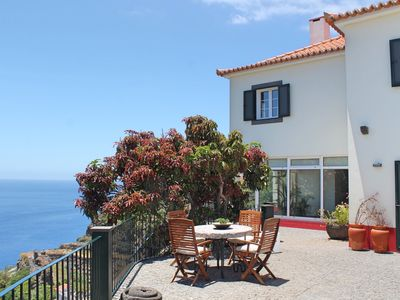 Photo for Overlooking Calheta Beach, quality private villa, heated pool | Casa Do Julio