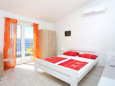 Photo for Studio flat with balcony and sea view Stanići, Omiš (AS-17894-c)