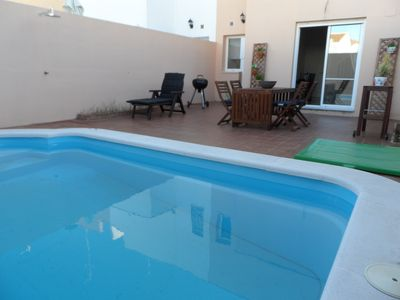 Photo for New townhouse with pool in charming village close to the city of Seville
