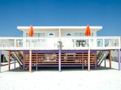 Photo for Beachfront Sunswept cottage, sunsets, close to pier, restaurants & shopping
