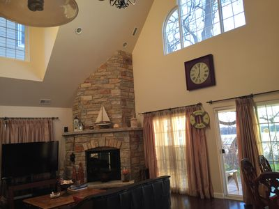 Great room features a 2 story Chilton rustic stone wood burning fireplace..