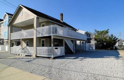 Photo for Comfortable Condo with Huge Wrap-Around Deck. Only 5 Minute Walk to the Beach