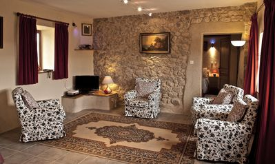 Bright Living Area with fantastic stone wall