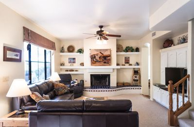 leather sofa and loveseat overlooks gas fireplace and huge view window