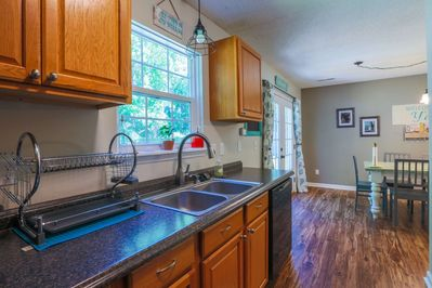 The home features a galley kitchen with wood floors and terrific natural light.