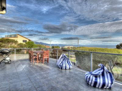 Photo for Blue Waves ~ Spacious house with ocean view and outdoor dining on the sundeck.