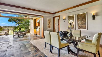 Elegant dining area, with floor-to-ceiling pocket doors that open to the lanai.