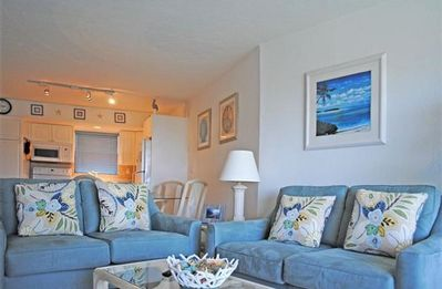 Photo for Modern top floor unit with a beautiful view of the bay, pool, and tennis courts.