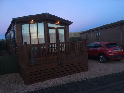 Photo for Holiday Cabin just yards from the beautiful beach off Montrose