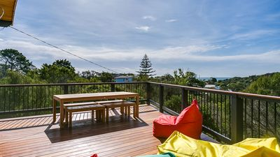Photo for Offers beautiful views across the tree tops to the bay beyond from outdoor deck