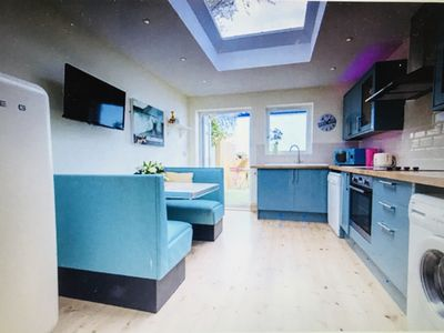 Photo for Gorgeous and funky basement flat with parking and decking. Large light kitchen.