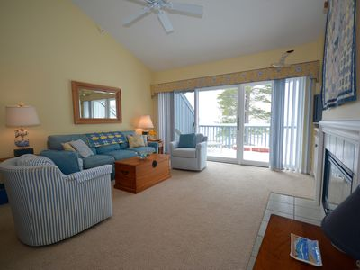 Photo for Delightful Homestead Beachfront Condo - Epic Sunsets Over Sleeping Bear Bay