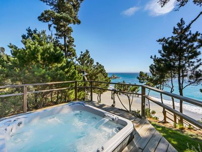 Photo for Waterfront home with private hot tub, patio, and beach access!