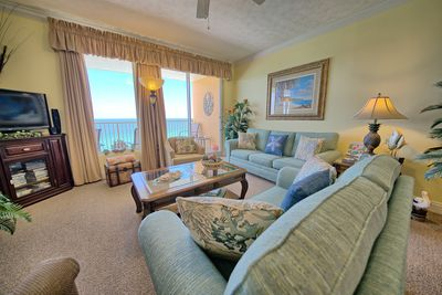 STEP OUT OUT OF THE LIVING AREA ONTO THE HUGE PATIO OVERLOOKING THE GULF .