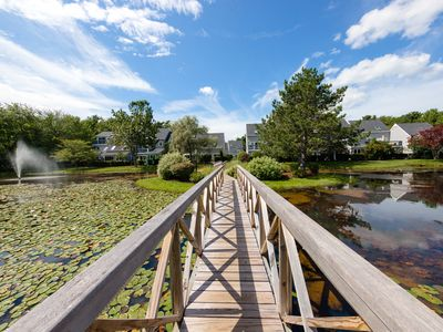 Photo for Cape Cod style condo w/grill & shared pool, sauna, gym - near beach