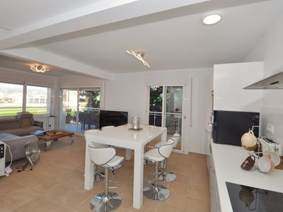 Photo for Modern apartment 500 metres from the beach, with terrace, Wi-Fi, shared pool, Ref. A067