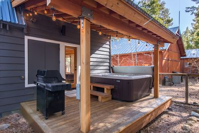 Hot Tub - Under the back porch cover, the hot tub invites guests to relax and unwind.