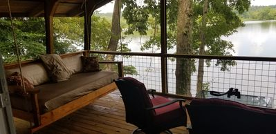 View of the bed swing overlooking the lake.