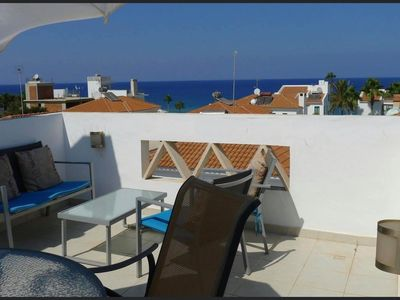 Photo for Villa Omorfo Theire has amazing roof top terrace sea views, right by Sirena Bay.