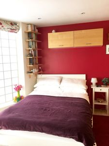 The bright double bedroom. The bed has a new mattress with a memory foam topper.