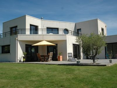 Photo for Modern villa in a large garden just minutes from the sea