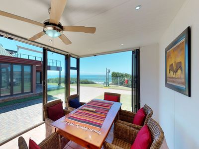 Photo for Cozy bungalow w/ gorgeous views of the water - walk to the beach!