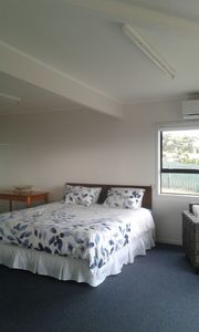 Photo for 5 minute walk to Coopers Beach, and local shopping centre.  Shared facilities.