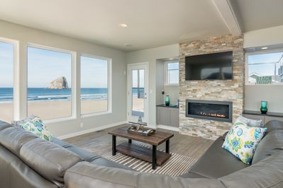 Oceanfront living room with leather sectional, gas fireplace, Blu Ray player and beautiful ultra high-def flat screen,