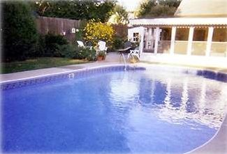Pool house, pool area, grill area and perennial gardens