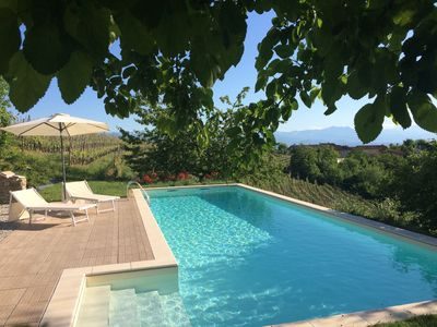 Photo for Panoramic villa on the hills of the Langhe nestled among the park pool vineyards