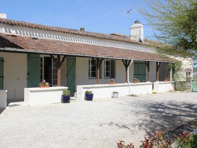 Photo for Large family and pet friendly farmhouse with substantial grounds & swimming pool