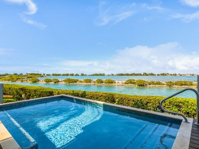 Photo for Luxurious, waterfront home w/ ocean views, a roof deck, & private pool