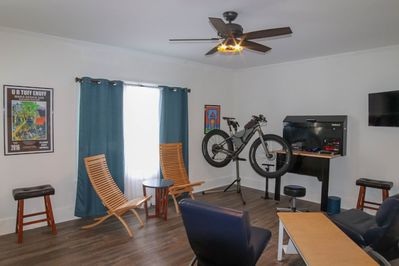 Living Room with Bike Repair and Storage