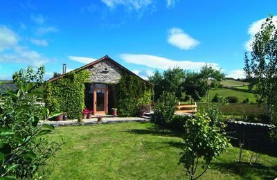 Photo for This detached barn conversion offers panoramic views over stunningly beautiful countryside.