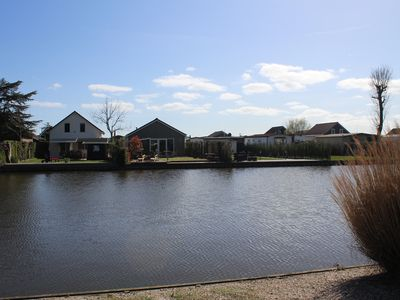 Photo for Cottage on the water in Holland with private dock - fishing vacation & more