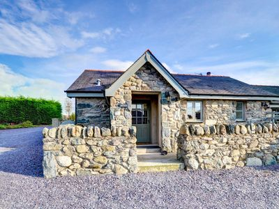 Photo for In the grounds of the owners' home close to Caernarfon is Bwthyn a well furnished cottage on one lev