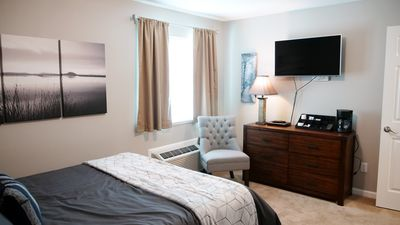 Guest suite with bed and TV