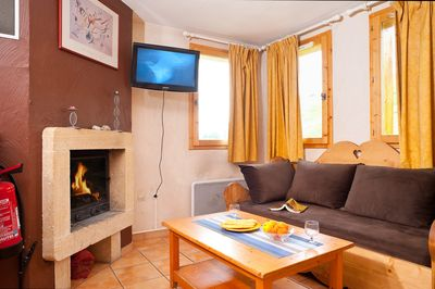Relax and rejuvenate in the cozy living room of our ski-in/ski-out chalet!