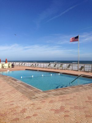 Large saltwater pool is heated and adjacent to the beach.